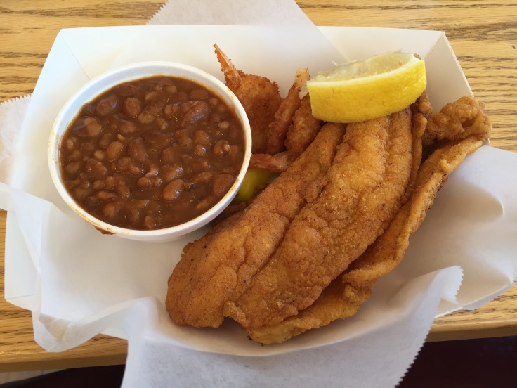 two pieces of catfish with baked beans