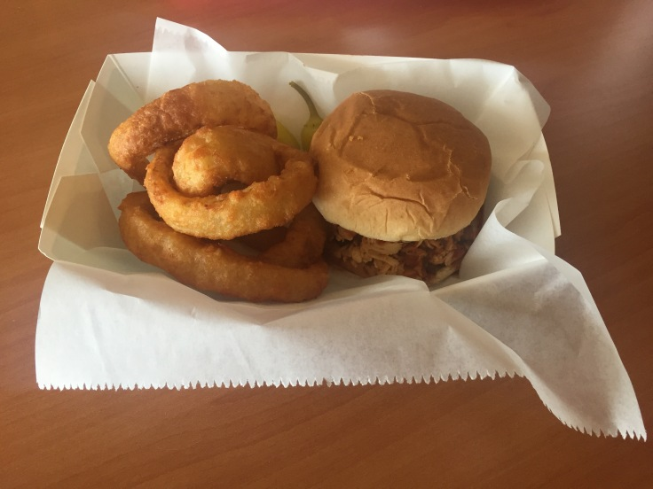 pulled chicken sandwich and onion rings