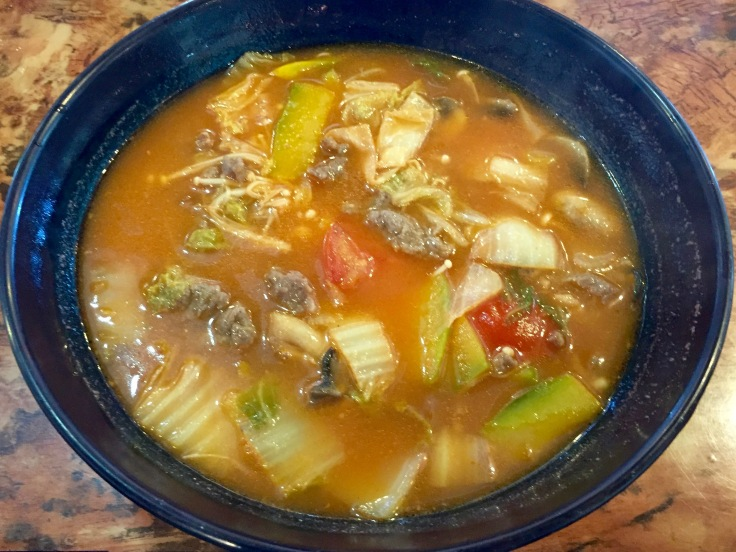 tomato and pumpkin broth with sliced beef and Korean noodles