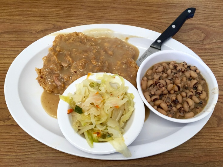 chicken fried steak with cabbage and black-eyed peas