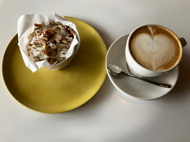almond poppyseed muffin and cappuccino