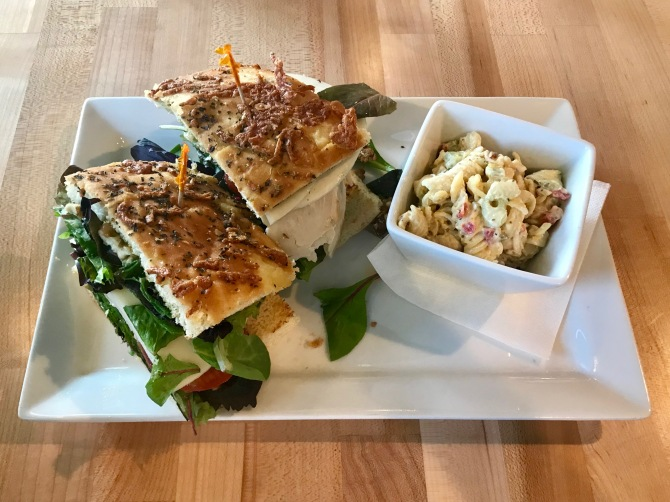 turkey pesto sandwich with side pasta salad