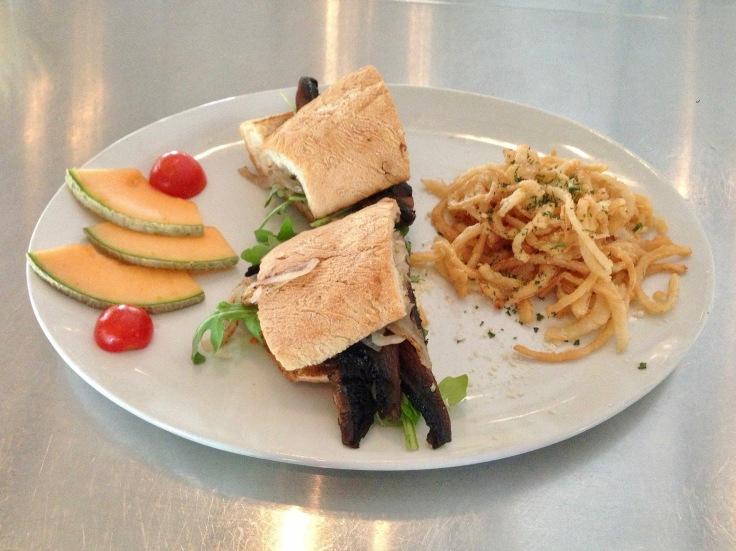 portobello sandwich with onion strings
