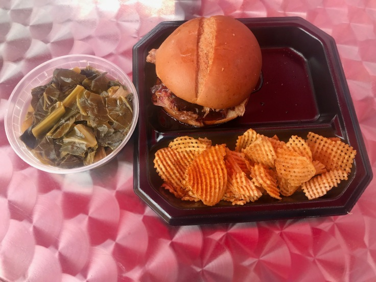 pulled pork classic sandwich with chips and collards