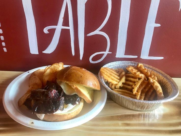 short rib sandwich and waffle fries