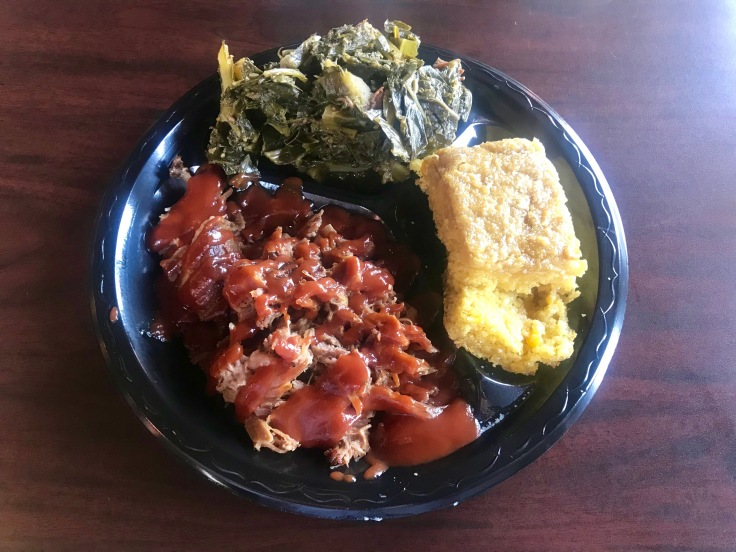 chopped BBQ pork with collard greens and cornbread