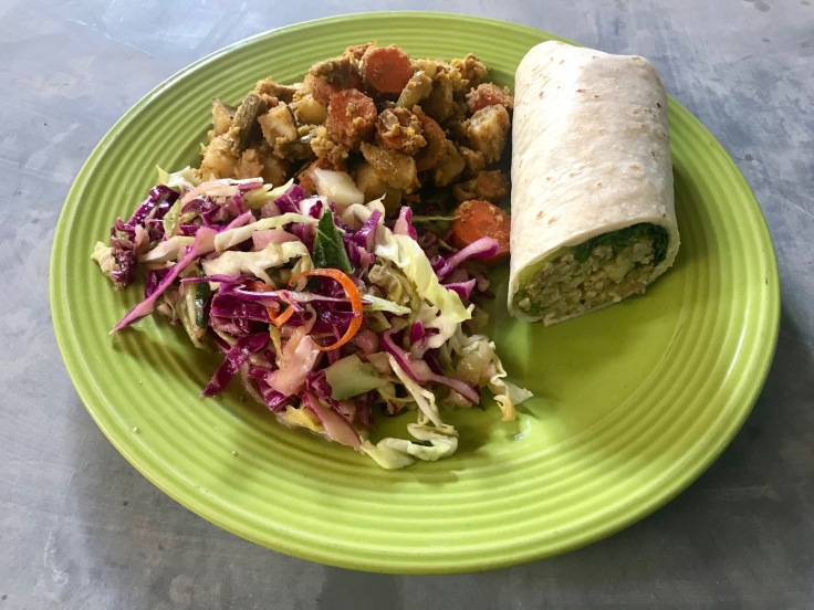half wrap, green curry roasted potatoes and carrots, apple cider vinegar basil slaw