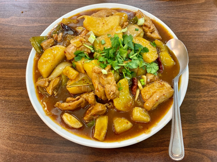 stewed spicy chicken with potatoes and peppers