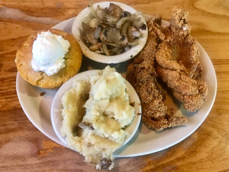 soul food platter with catfish, whipped potatoes, and mushrooms with onions