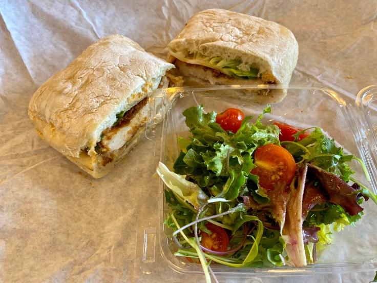 crispy chicken sandwich and salad