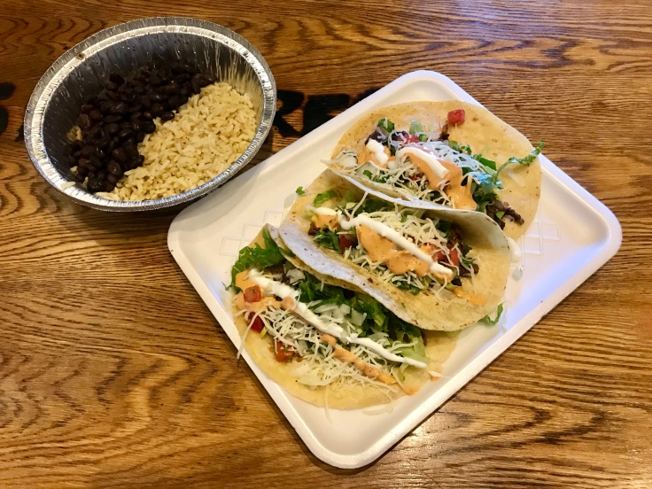flour tacos with rice and black beans